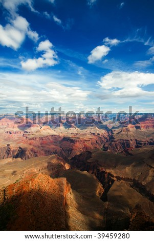 Light and shadow playing on texture of the Grand Canyon featuring Bright Angel Trail