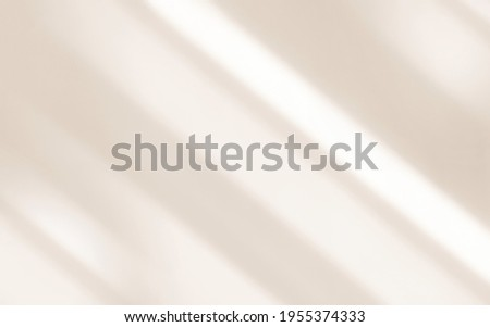 Light and shadows lines from curtain and silates on the white wall. Sunny day, the sun's rays. Mockup, copy space for text