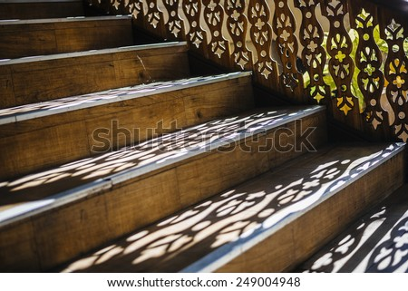 Light and shadows on wooden stairs.