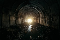 Light at the end of dirty sewer tunnel