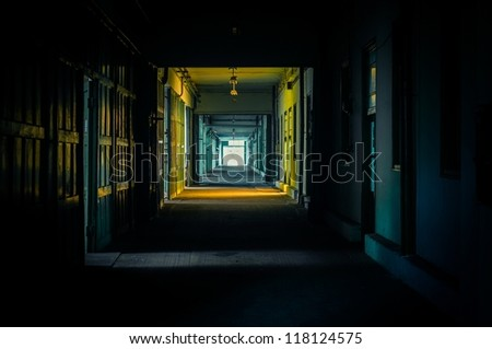 Light at the end of the hallway in dark colors