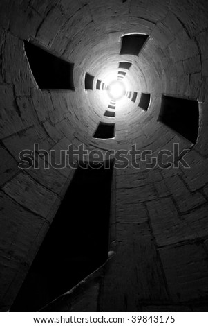 Light at the end of the tunnel. Black and white, image taken in Chateau de Chambord (staircase designed by Leonardo da Vinci).