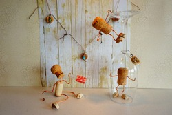 Light Background with Wine Corks having a Party Corks as People Cork trapped in wine glass