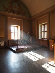 light beams pouring through the window. empty St. Sampson Cathedral in St. Petersburg. There are no people in the church in quarantine