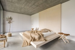 Light bedroom with wooden ceiling and large bed