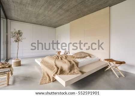 Light bedroom with wooden ceiling and large bed #552591901