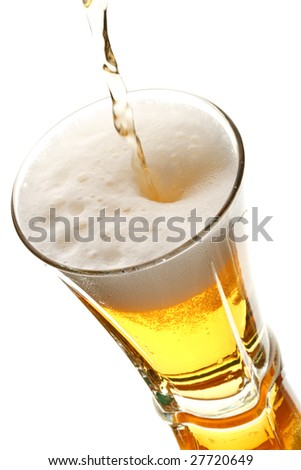 Light beer poured in a glass isolated on a white background