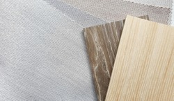 light beige and brown wooden veneer samples matching color with interior fabric in zigzag pattern texture samples. fabric strip line ,herringbone pattern design.