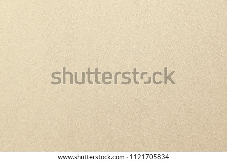 Light beige leather background or texture.