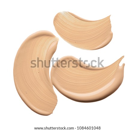 Light beige makeup smear of creamy foundation isolated on white background. Light beige creamy foundation texture isolated on white background