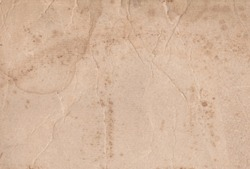 Light beige weathered vintage old paper parchment texture background