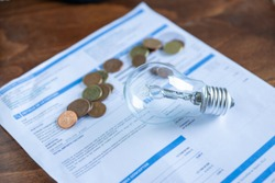 Light bill with light bulb. Conceptual about the price of electricity and paying taxes