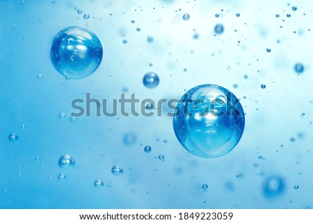 Light blue Air bubbles in alcohol gel. anti virus COVID-19 backdrop. Abstract background about cleanliness, shampoo bubbles, macro bubbles