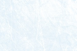 Light blue and white ice texture with scratches - background for ice hockey or skating on frozen winter lake