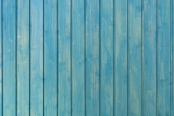 Light blue background of vertical boards. Smooth and clean tree background. Wooden texture. Background with soft pastel tones.