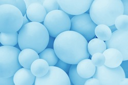 Light Blue balloons background, punchy pastel colored and soft focus. Party festive balloons photo wall birthday decoration for children. Background for wedding, anniversary, birthday.