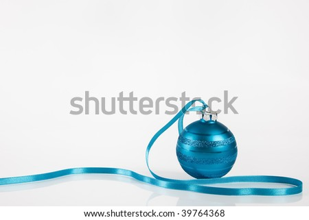 Light blue christmas ornament on white background