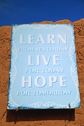 Light Blue Colored Inspirational Quote Board on the Clay Wall