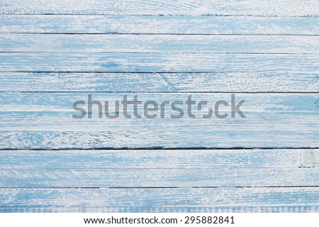 Light blue colored wooden background
