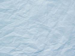 Light blue crumpled paper texture background