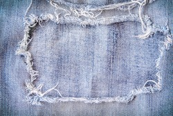 Light blue denim frame texture with  torn patterns abstract for background and space