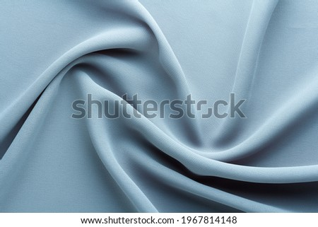 light blue fabric draped with curl folds, textile background Photo stock ©