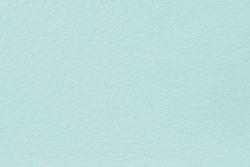 Light blue felt background. Surface of fabric texture.