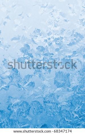 Light blue frozen window glass background - stock photo