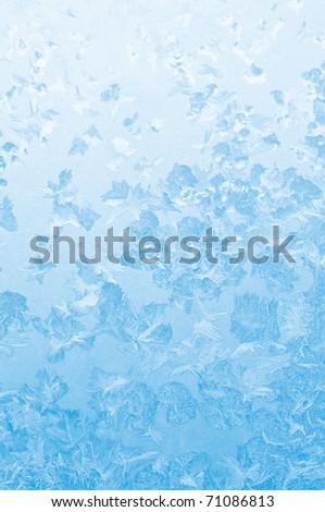Light blue frozen window glass background