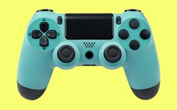 Light blue gaming controller on yellow background.