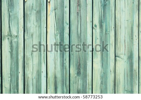 Light blue-green painted weathered wooden fence texture