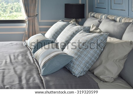 Light blue pillows in difference pattern with classic style bedding