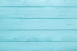 Light blue plank texture of wood table. Trendy pastel coloured background.