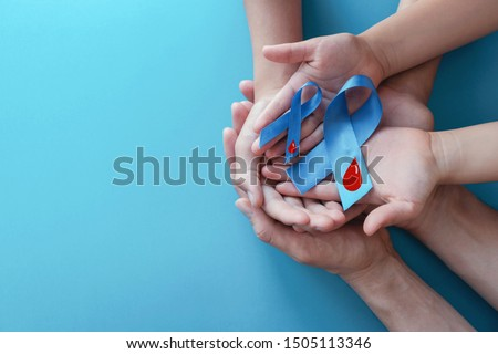 Light blue ribbons with blood on blue background , world diabetes day