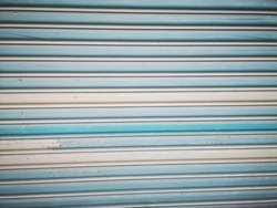 light blue rolling doors with staines and different shades