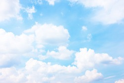 Light blue sky with white heap clouds - Summer cloudscape,  may be used as background