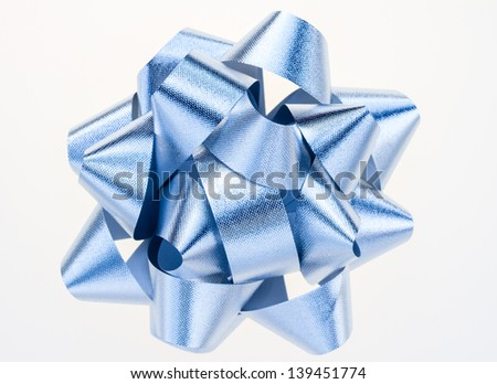 Light blue textured bow isolated on a white background.