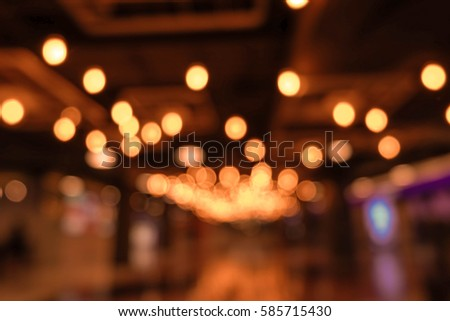 light blur background with bokeh in the shopping mall, dark blurred background