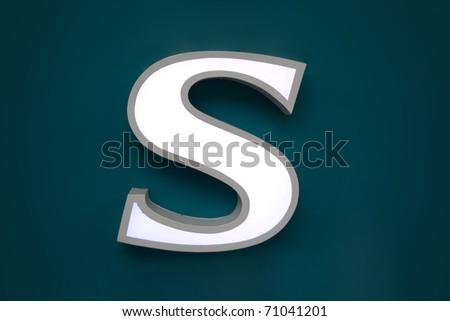 light box of 'S' alphabet symbol on green wall
