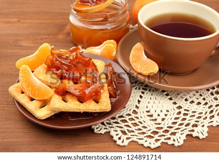 light breakfast with tea and homemade jam, on wooden table