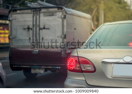 Light Bronze Gold Sedan Can and Dark Red Utility Truck Traffic Jam in City #1009009840