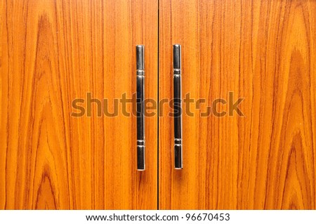 light brown doors with metal handles