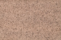 Light brown fluffy background of soft, fleecy cloth. Texture of beige wool textile backdrop, closeup.
