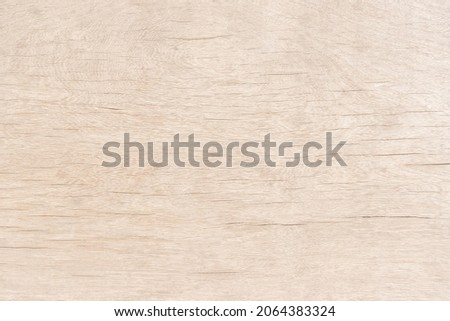Light brown wood there are stains on the surface for background texture and copy space