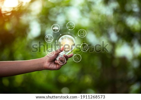 light bulb against nature, icons