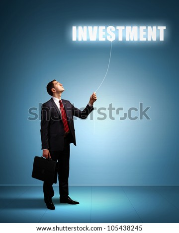 Light bulb and a business person as symbols of creativity in business - stock photo