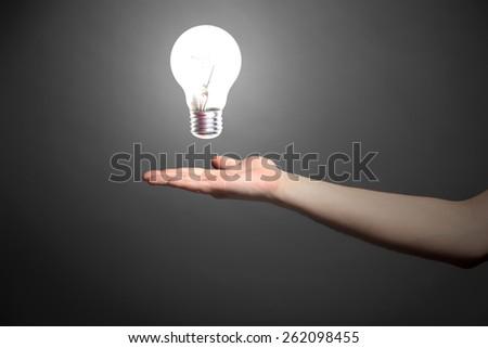 light bulb as hand