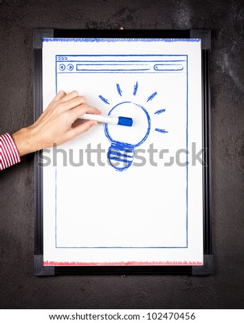 Light bulb & browser sketch on a whiteboard. Online Ideas.