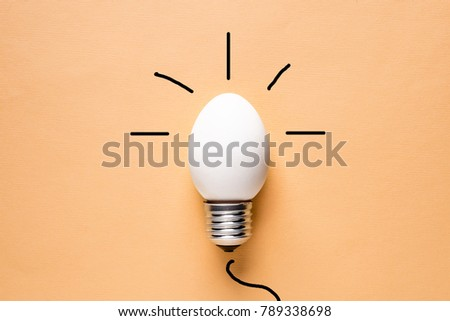 Light Bulb Egg shell on Base Concept  Energy Saving Ecology Natural Energy Sources Conservation of Natural Resources