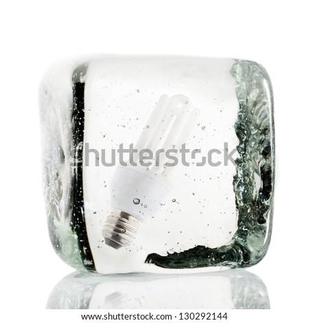 Light bulb frozen inside a block of ice